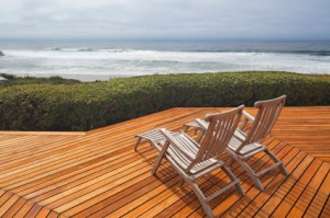 Wooden verandah with view and beach chairs